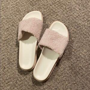 Light pink plush slides